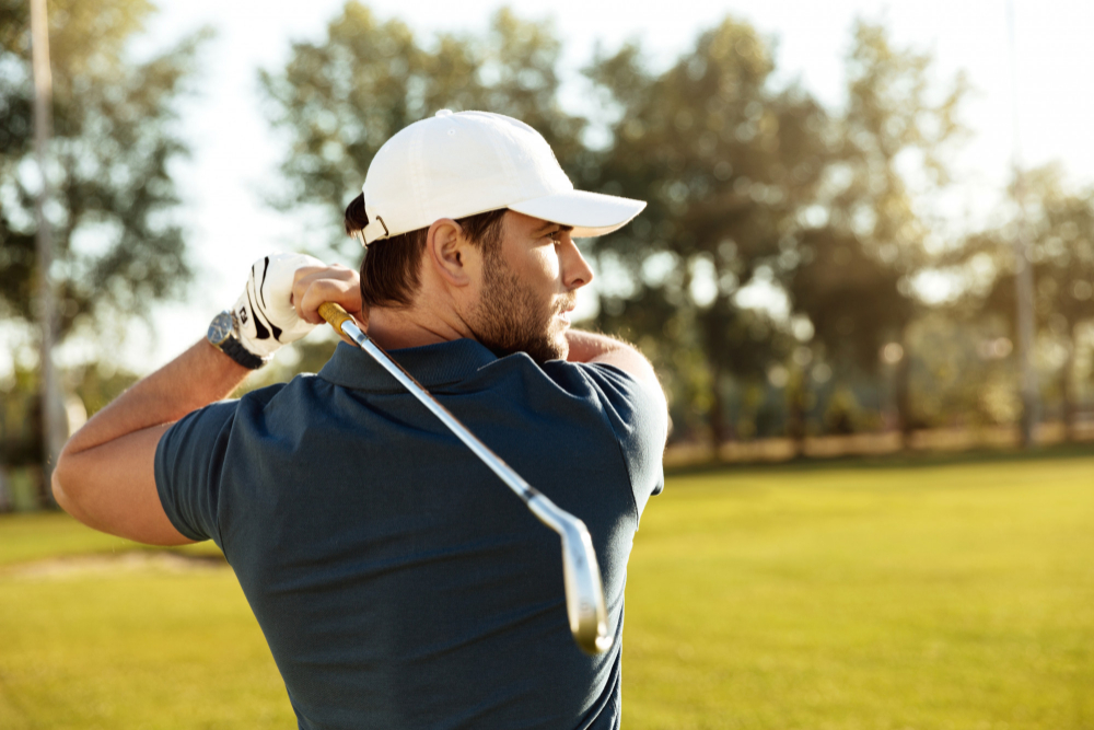 close-up-young-concentrated-man-shooting-golf-ball