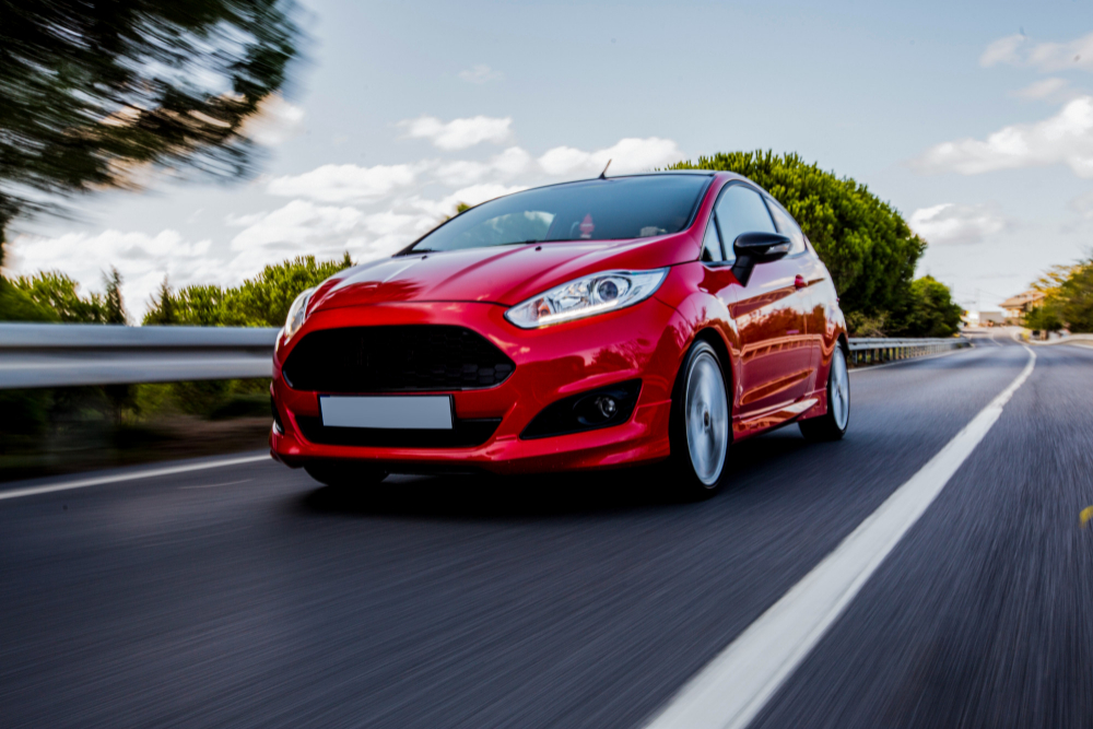 red-mini-coupe-driving-highway-with-high-speed